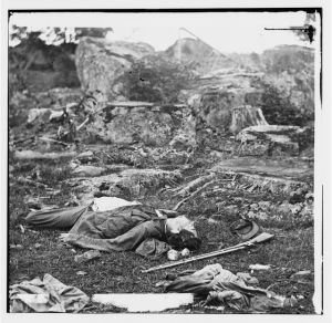 """Gettysburg, PA. Dead Confederate Soldiers in """"The Devil's Den"""" - Left Stereograph Image"""