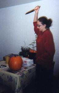 A very serious pumpkin carver hard at work.